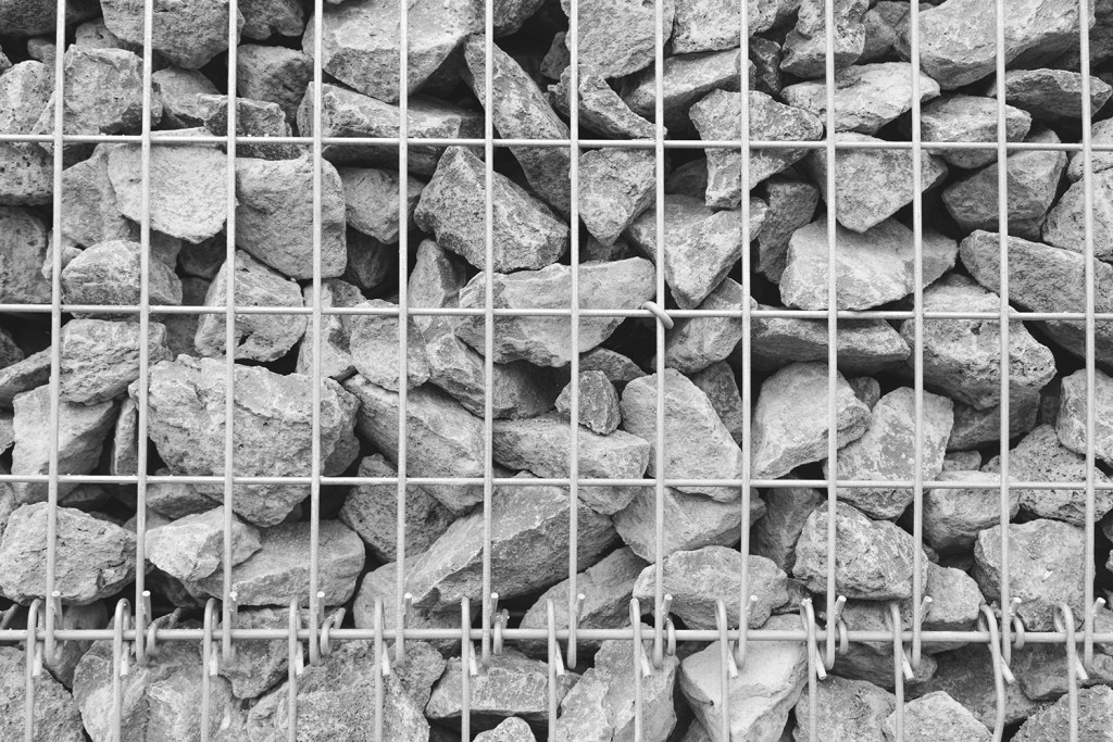 Sunday, July 5th, 2015 in Oberursel - Number 187 of 366mm Stones behind bars of a wall from the swimming bath parking place in Oberursel