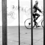 Wednesday, August 19th, 2015 in Frankfurt - Number 232 of 366mm Bicycle rider behind railings
